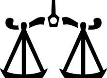 مطلوب محامي يقوم باستخراج وثيقة إشهاد من المحكمة في بنغازي