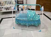 سرير طفل الكتروني