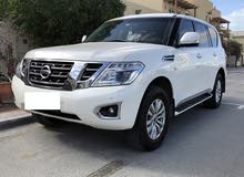 White Nissan Patrol 2014 model in immaculate condition with low mileage - 65,000 kms only.