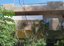 دار في حي القاهرة على شارع تجاري