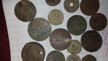 قطع نقدية قديمة 25سنتيم عهد باي تونس 1920 و قطعة أثرية من عام 1360