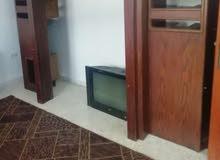 خزانة تلفزيون مع تلفزيون... التلفزيون بحاجة لصيانة