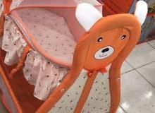 سرير بيبي الوردي مستعمل ....سرير بيبي البرتقالي جديد