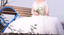 فستان زفاف رائع ملوكي  لون off white