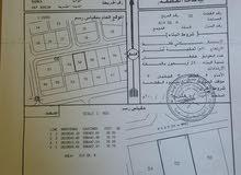للبيع ارض سكنية ممتازة في بركاء حي عاصم على ثاني خط من شارع الخدمات الرئيسي
