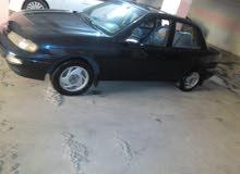 Blue Kia Sephia 1995 for sale