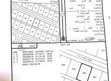 أرض سكنية في منطقة البريك موقع ممتاز جداً ويوجد منازل قائمة بالقرب منها