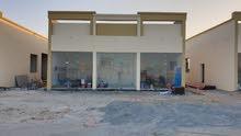 مبنى محلات بالزاهيه مدخل مشروع المها فيليج الشارع ال 38 للبيع OO