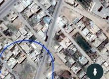 أرض للبيع في ريف دمشق على الشارع العام في معظمية القلمون