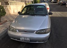 كيا افيلا 98