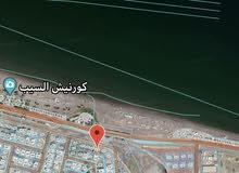 للبيع أرض سكنية سور آل حديد على الطريق البحري