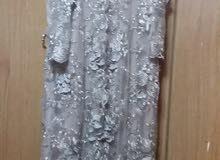 فستان سهرة النمرة 50