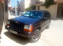 For sale 1997 Blue Grand Cherokee