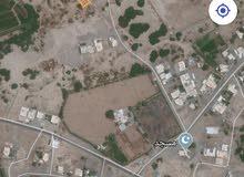 ارض في الملتقي وسطيه مربع 12مطابقه بيت