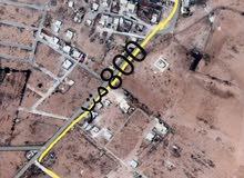 أرض خلف مسجد أم المبروكه بسعر مغري