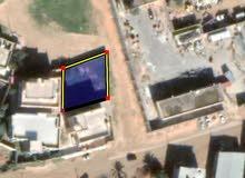 قطعة ارض500م واجهتين مسورة وباب قريبة من المعبد تاجوراء سبان امام مصرف الجمهرية