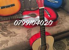 جيتار جديد بالكرتونه كبير نوعيه فخمه مع ريشه ووتر هديه  السعر 27 دينار