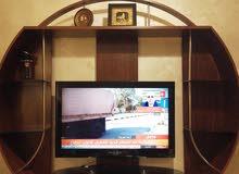 طاولة تلفزيون بحالة الجديد للبيع