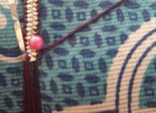 التلي او الغولي او الزري معروف لتزين ثوب  النساء