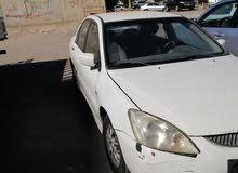 ميتسوبيشي لانسر 2004 اللون أبيض
