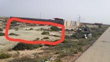 قطعة ارض للبيع فى زوارة بمطقة المنقوب مساحتها تتجاوز 600 م