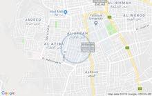 قطعة أرض للبيع غرب إشارة النسيم ، شارع السروات ، مطلة على شارعين