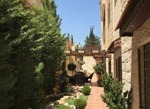 شقة شبه أرضي مع حديقة وكراج للبيع في دير غبار