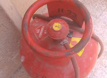 red colour cooking cylinder