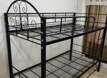 سرير حديد بدورين
