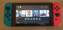 NINTENDO SWITCH ORIGINAL WITH FREE GAMES FOR 105