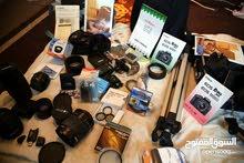 كاميرا كانون 2300 دينار بجميع ملحقتها