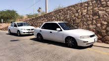 Manual White Kia 1996 for rent