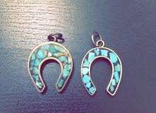 Horse shoe symbol made from silver and precious stones of Fairuz