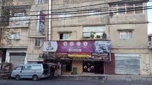 عمارة تجاري على ثلاث طرق تجاري مؤجرة في إربد شارع فوعرا