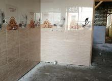 جزء من عملي تغليف وتطبيك السيراميك والمرمر ارضيات جدران