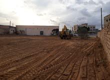 أرض تجارية ثلاثة واجهات 2400 متر بعد كوبري الشاحنات ب 500 متر للبيع او الاستثمار