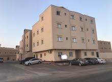 عماره 14شقه على شارعين المساحه 400م
