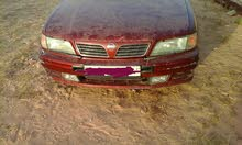 For sale 1997 Maroon Maxima