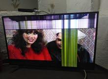 تلفزيون كبير مكسور الشاشه شغال
