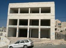 مجمع تجاري بموقع مميز على أكبر دوار بضاحية الياسمين للبيع شارع البنوك