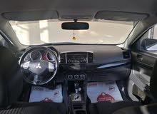 (لانسر 2014 للبيع) FAST SELL Mitsubishi white lancer 2014