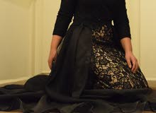 فستان اسود كم طويل