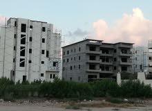 ارض بناء 145 متر مسجله وبها جميع الخدمات وفي قلب حي الفيلات وبجوار كارفور
