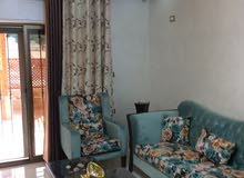 شقة طابق أرضي مساحة 230م مع ترس للبيع/ الزهور 32