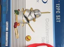 للبيع طقم اواني من  12 قطعه مطلي 24قيراط ذهب (جديد بالكرتون)