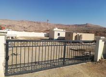 ارض صناعية بها سور للايجار في صناعية المسفاة بوشر المرحلة الثانية