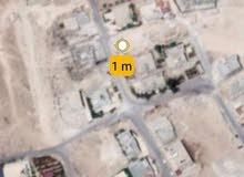 ارض في حي الاحمد. الزواهرة.