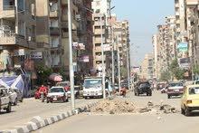 شقه للبيع شارع الجلاء الرئيسي قريبه من بوابه الجامعه
