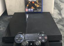 Playstation 4 with game