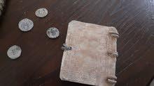 مجموعه عمله مع كتاب قديم ومخطوطه بسعر مغري للجادين
